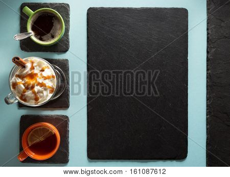 cup of coffee, tea and frappe at paper colorful background