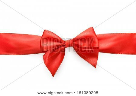 Red satin bow isolated on white background, whole object is cut with clipping path