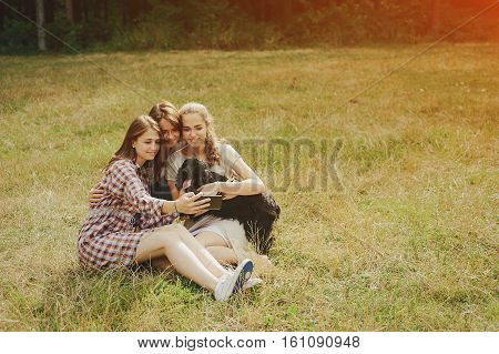happy family on a picnic. play with the dog. good time.