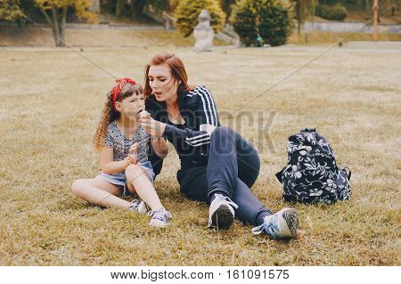 girl walking park eating ice cream good time using communication