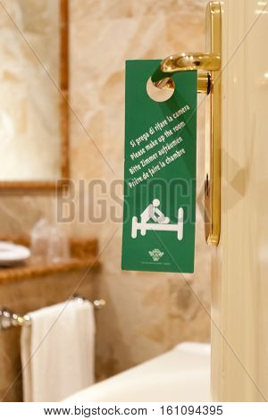 Green sign on the door of the hotel with