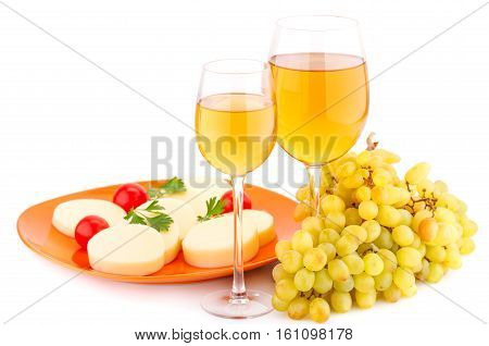 Wine grapes cheese and tomatoes isolated on white background.