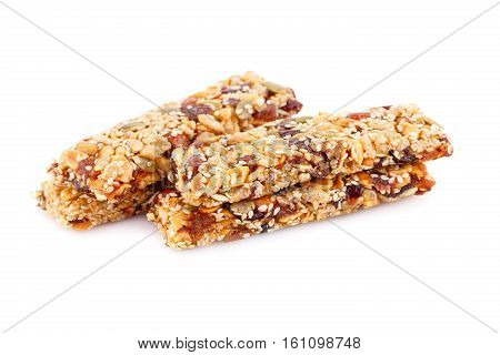 Cereal bars with different nuts and seeds isolated on white background.