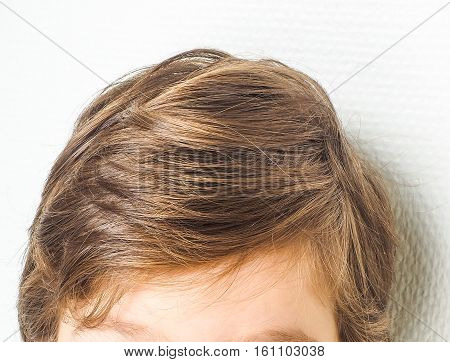 Closeup Of A Neet Hairstyle On A Young Boy, Towards A White Wall