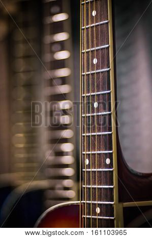 Close view of guitar fretboard with a blurred background