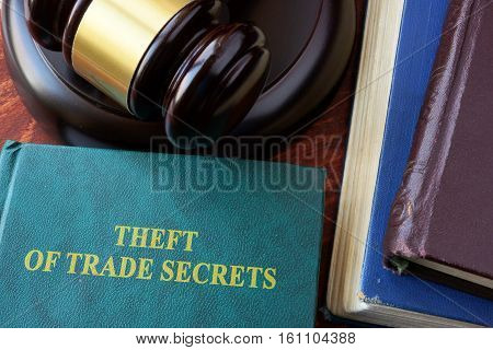 Theft of Trade Secrets title on a book and gavel.