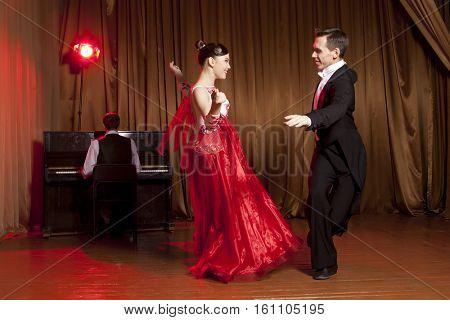 Dance beautiful couple dancing ballroom dancing on dark background