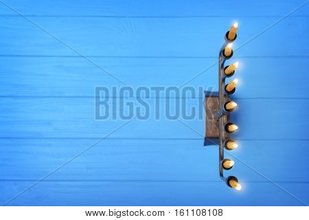 Menorah with candles for Hanukkah on  wooden table