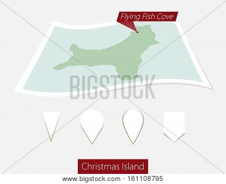 Curved Paper Map Of Christmas Island With Capital Flying Fish Cove On Gray Background. Four Differen
