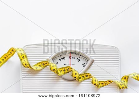floor scale and centimeter to measure on white background top view.
