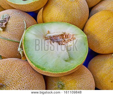 juicy organic melon cut closeup at the local market