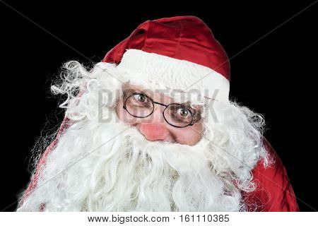 Santa Claus Portrait In The Christmas Night Isolated On Black Background