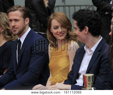 LOS ANGELES - DEC 7: Ryan Gostling, Emma Stone, Damien Chazelle at the 'Ryan Gosling and Emma Stone hand and footprint ceremony' at TCL Chinese Theatre IMAX on December 7, 2016 in Los Angeles, CA