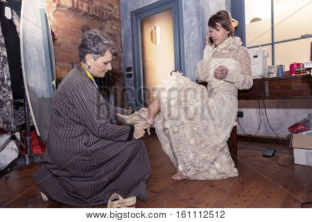 Young Girl Is Trying A Wedding Dress In A Dressmaking Studio