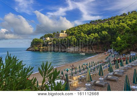 Apula coast,Gargano National Park: Pungnchiuso beach. Vieste,Italy.The bay is bounded by marvellous hills covered with age-old pine trees.
