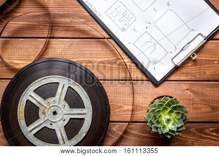 Work screenwriter on wooden background top view.