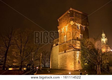 Medieval Thieves tower at night. Is tower - one of the three extant fully towers at Wawel Castle. It was built in the XIV century in the line of gothic defensive wall and was rebuilt by the Austrians.
