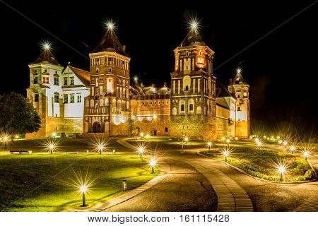 Mir, Belarus - August 24,2016:  Illuminated medieval castle in the Belarusian town of Mir at night