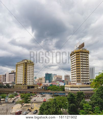 Kuala Lumpur, Malaysia - February 7, 2016: Panoramic view of the tourist district near Chinatown in Kuala Lumpur. Cars and public transport move along Jalan Pudu Street in the city center.