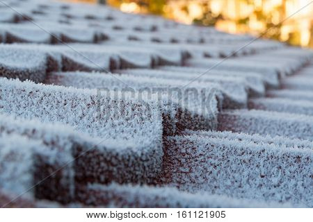 cold snap creating frost on a tiled roof