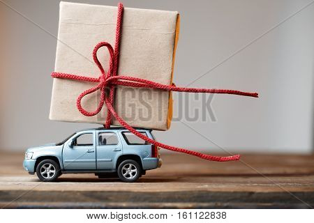 Postcard with car carrying gift