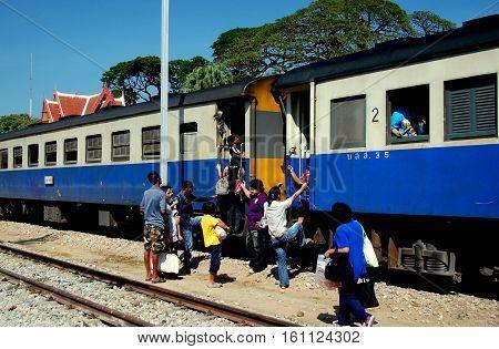 Hua Hin Thailand - December 31 2009: Passengers boarding a local Thai Railways train at the Hua Hin Railway Station *