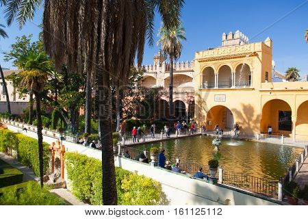 Seville Spain - November 182016: Real Alcazar Gardens in Seville.The Alcazar of Seville is a royal palace in Seville Spain originally developed by Moorish Muslim kings.
