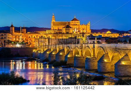 The Roman Bridge across the Guadalquivir river and the Mosque-Cathedral in Cordoba, Spain