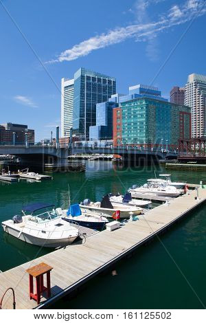 BOSTON MASSACHUSETTSUSA - JULY 15 2016: Boston skyline and Northern Avenue Bridge. Built in 1908 it was closed to vehicle traffic in 1999