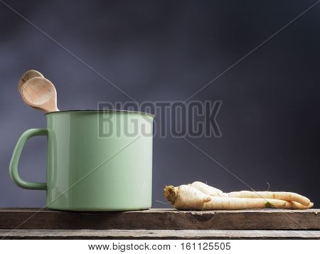 Parsley root on a rustic wooden table