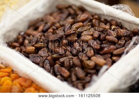 Date fruit closeup background. Date fruits on food store shelf on fruit market
