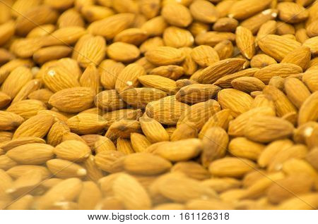 pile of almond nuts in food shop