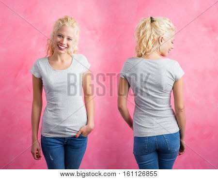 Woman in grey round neck T-shirt on pink background