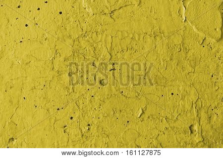 Plaster, yellow plaster on a concrete wall. Stucco yellow wall background or texture. Plaster, plaster texture, plaster background. Yellow wall, yellow background. Color plaster.