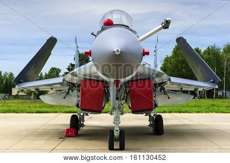 Fighter-bomber jet, military multifunction plane with folded wings for using on aircraft carrier deck, modern army, navy aviation and aerospace industry, supersonic air force