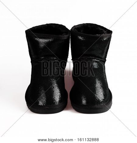 stylish winter black boots over white background