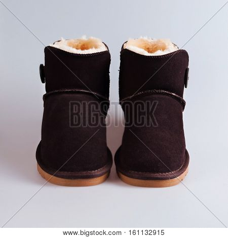 stylish winter brown boots over white background