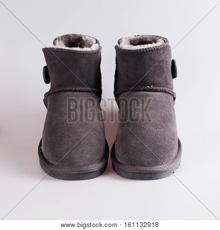 winter female gray boots over white background