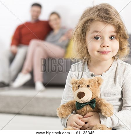 Boy Hugging Toy With Parents