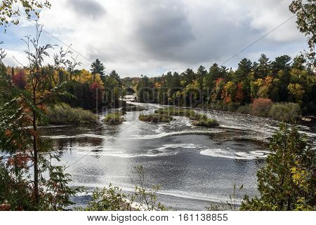 Tahquamenon River and Lower Falls in the Tahquamenon Falls State Park in autumn, Chippewa County, Michigan, USA