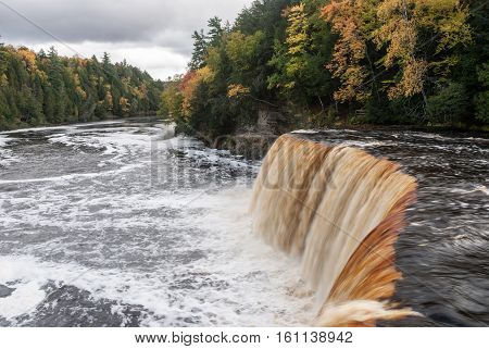 A very picturesque Tahquamenon Falls and the Tahquamenon River in Autumn, Chippewa County, Michigan, USA