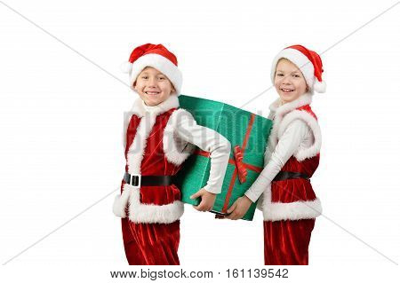Adorable Happy Boys In Santa Clothes Holding Christmas Gift Box. Isolated White Background.