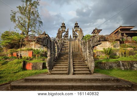 Traditional Hindu temple Pura Agung on sunset. Island Bali. Indonesia