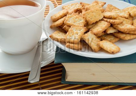 View Closeup On A Cup Of Tea And Dry Crackers
