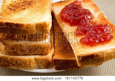Toasted Slices Of Bread With Strawberry Jam Close-up