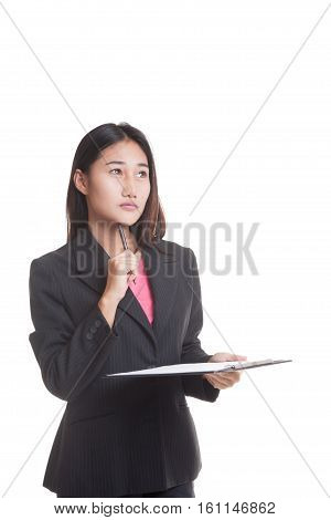 Young Asian Business Woman Thinking With Pen And Clipboard..
