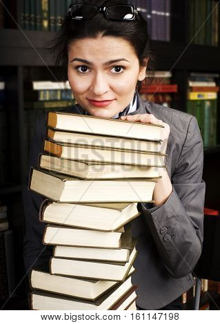 young teen girl in library among books emotional close up bookwarm, lifestyle people concept