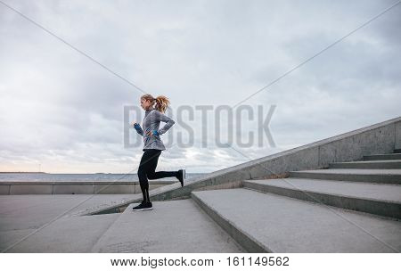 Healthy Young Woman Running Down The Steps