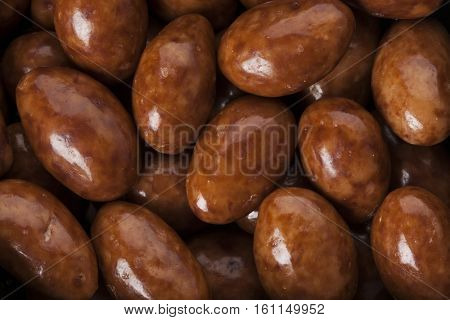 background of chocolate covered almonds