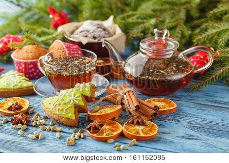 Mulled Tea With Spices And Festive Christmas Decorations On Wooden Background With Copyspace